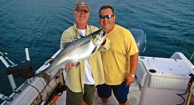 coho - Two fishermen and a salmon