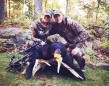 """Angela Cox and Ben Nelson. Angela says """"female blackbear dressed out at 220 pounds, first bear and first harvest by my crossbow. In Burleigh Falls."""""""
