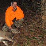 a hunter with a harvested doe