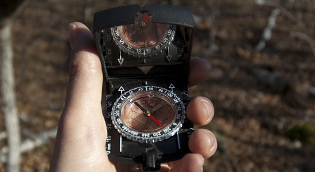 missing - hand holding a compass