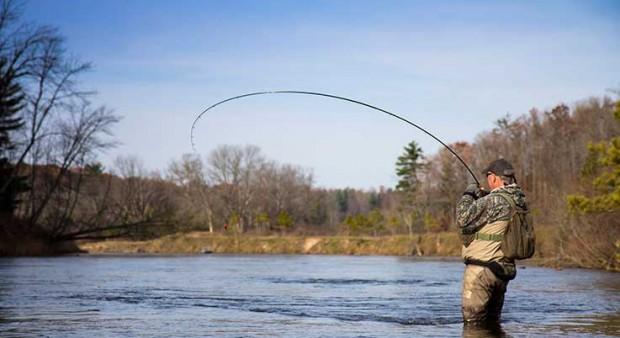 bank - a man fly fishing