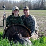father daughter with a turkey