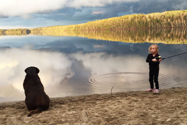 Girl on a beach fishing