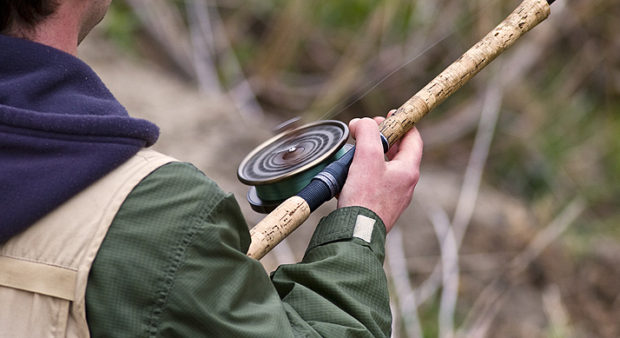 spin - guy holding a reel
