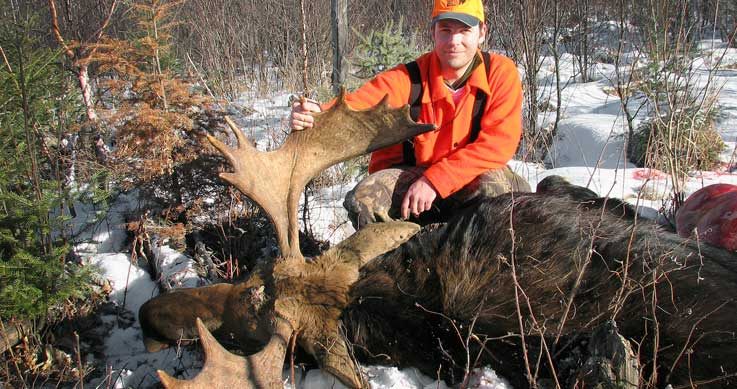 snow - Man with a harvested moose