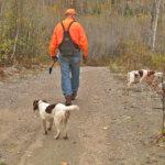 hunter with dog on path