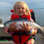 Rebecca Paisley, 4, holding her first salmon, caught on Lake Superior.