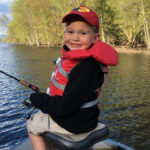 Burke Griffin, 4, fishing for crappie on the Ottawa River.