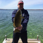 Gord Beaton of Waterloo with this nice smallmouth off the dock on Lake Couchiching.