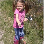 Meredith Acal catches her first fish at a top secret location with her dad Dave.