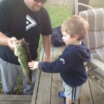 Mike Pelle and his son, Oliver (2), enjoy fishing at the cottage.