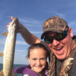 Nick and Brooke Lefaive of Belle River with her first northern pike caught on Lake St. Clair.