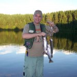 Tony Geden showing off his share of the catch on his first lake trout fishing expedition.