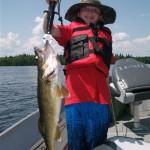 "Liam Miller, 10, scores a 20"" walleye on Lake Esnagi"