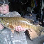 """Garrison Miller, 11, of Blyth landed this 20 3/4"""" five-pound small mouth bass with a girth of 13 1/4"""" while fishing with his grandfather Jim Keller in the Maitland River outside Belgrave."""