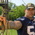 joe eppele holding a bow