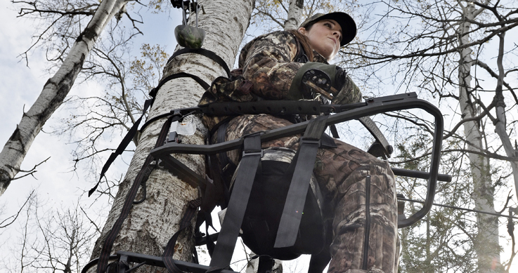 woman sitting in a tree stand