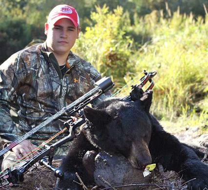 Chris Perkins with a bear