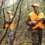 two hunters in thick woods