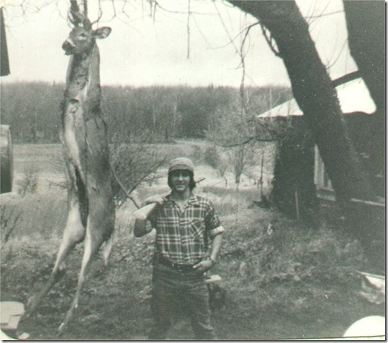 man in old photo with a deer