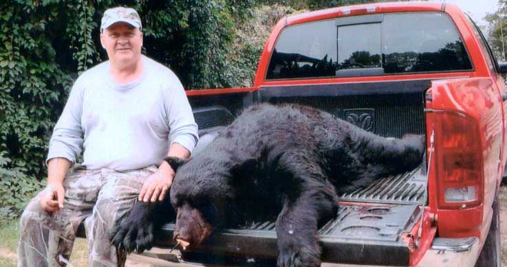 man with record black bear