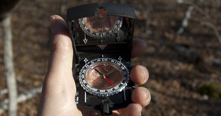 two lost - missing - hand holding a compass