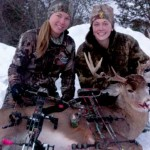 two women with a deer and bows