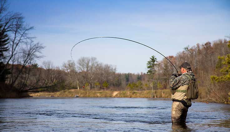 bank - a man fly fishing