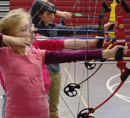 kids shooting bows