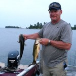 """Mike Hodgins """"hammerin' the bass' at a friend's camp on the north shore of Georgian Bay."""