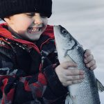 Wyatt Bergie with the herring he iced on Georgian Bay.