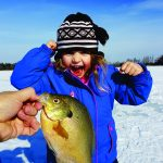 Olivia Lewis twitched her line to find this bluegill sunfish on the end of her favorite pink worm bait.